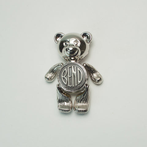 "Cute 2"" tall bear magnet with the Bend Oregon Logo with moveable arms and legs"