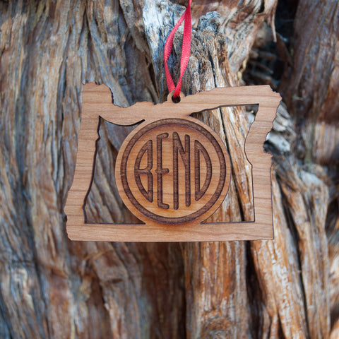 Bend Oregon logo ornament laser engraved in black cherry wood