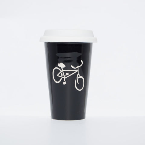 Black, Bend, Oregon souvenir travel coffee mug. Sandblasted with the picture of a bicycle.