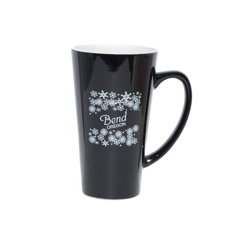 Black, Bend, Oregon souvenir coffee mug with white snowflakes.