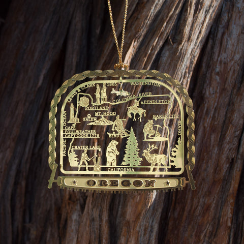 Detailed laser-cut, brass ornament in the shape of Oregon.