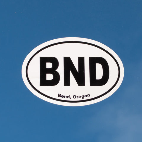 Oval, black and white souvenir decal that reads, BND, Bend, Oregon.