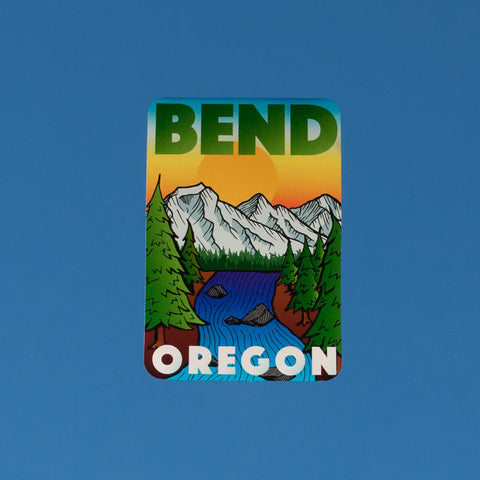 Multi colored souvenir decal that reads BEND, OREGON, and depicts mountains, trees and the Deschutes River.