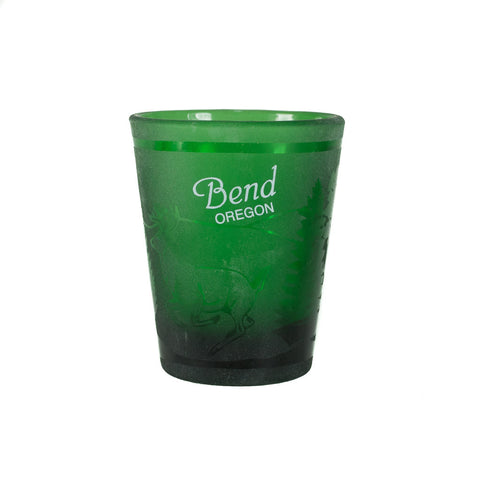 Green Bend, Oregon souvenir shot glass with a frosted forest scene.