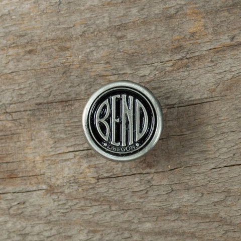 Small, pewter, city of Bend, Oregon, logo tack pin.