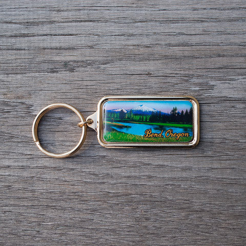 Bend, Oregon souvenir keychain with picture of Mt. Bachelor.