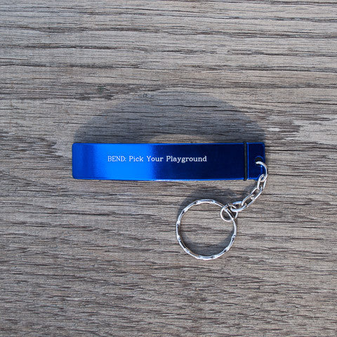 Blue, Bend, Oregon souvenir bottle opener keychain that reads, BEND: Pick Your Playground.