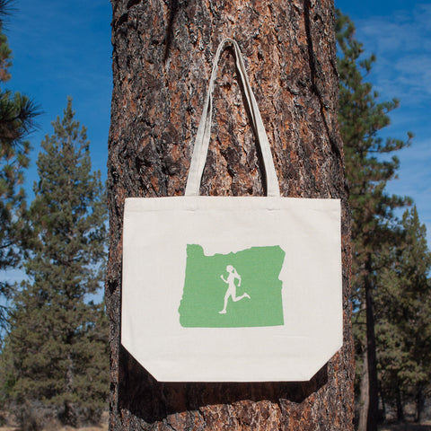 Large canvas tote bag featuring the state of Oregon with a female runner outline in the middle.