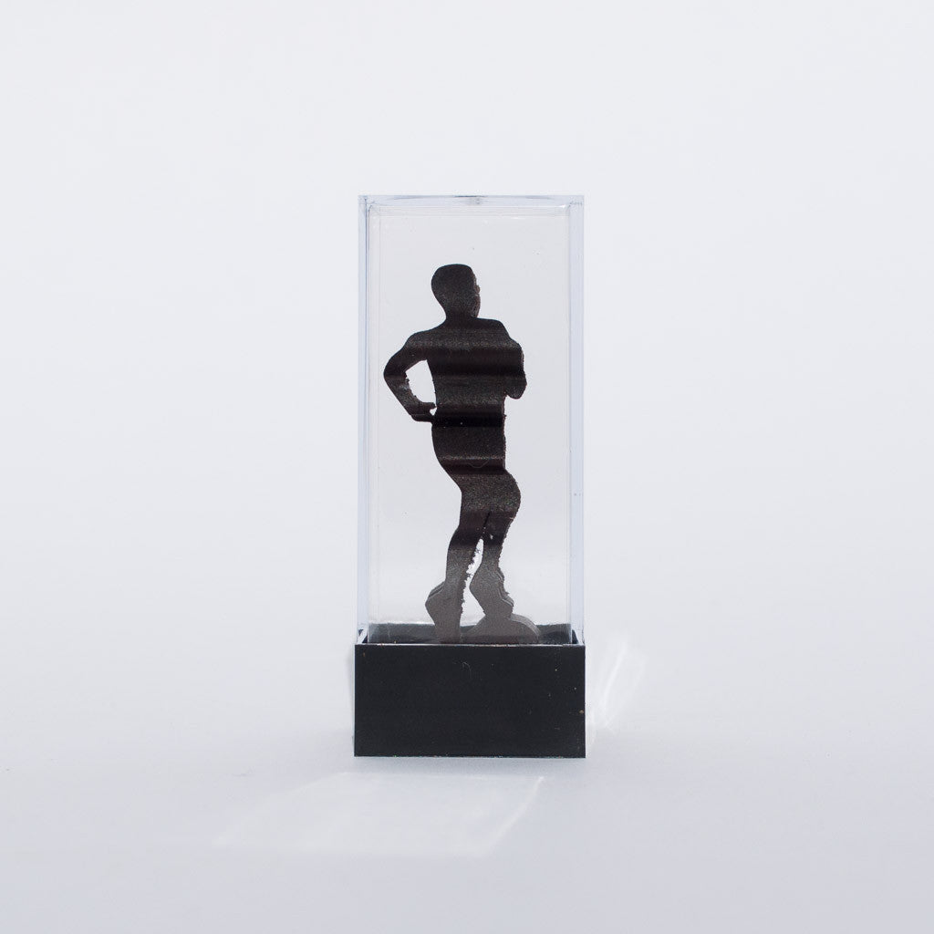 Bend, Oregon wooden souvenir mini carved sculpture featuring the word Bend and male runner.