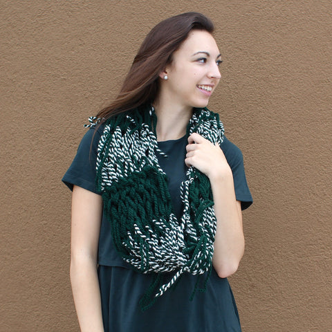 green handmade cowl with fringe details