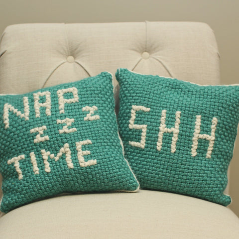 Handmade knitted cross stitch pillows with fun phrases nap time and shh