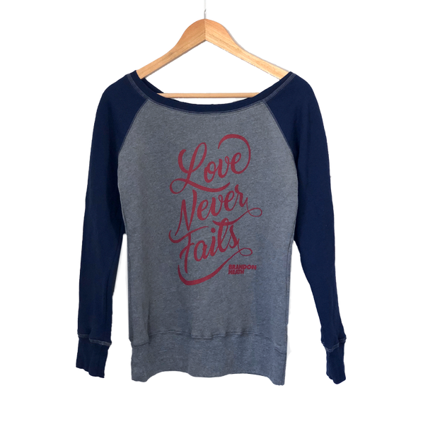 Love Never Fails Sweatshirt