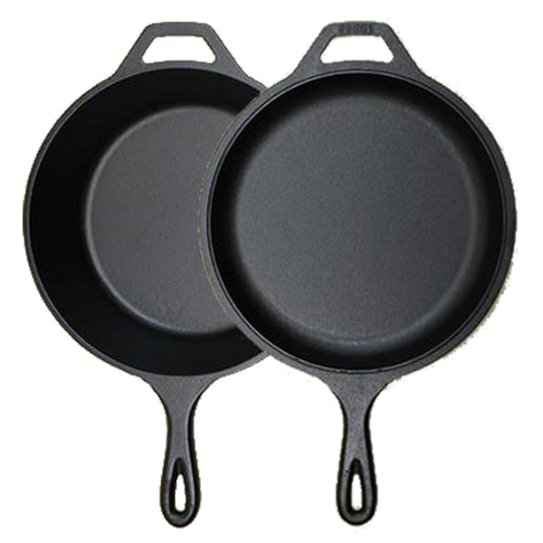 A black cast iron combo cooker, composed of a frying pan and a pot with a handle.