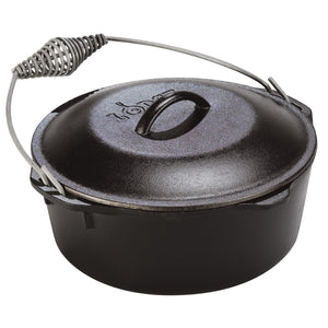 A black cast iron dutch oven with a bail handle and a lid with handle.