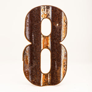A rusty corrugated metal number eight.