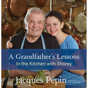 The cover of the book depicting the title and Jacques Pepin with his grand daughter in the kitchen.