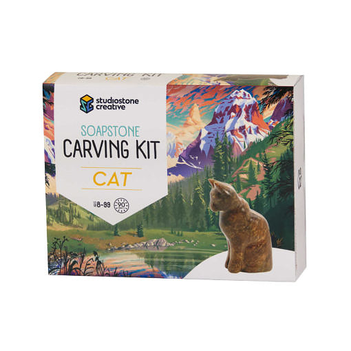 The front of a box with an illustrated BC landscape and a soapstone carving of a cat on it.