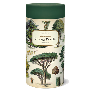 A cylindrical tube decorated with illustrations of trees and topped with a green lid.