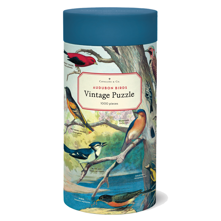 A cylindrical tube decorated with illustrations of birds and topped with a blue lid.