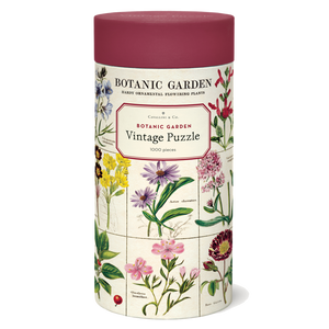 A cylindrical tube decorated with illustrations of flowers and topped with a burgundy lid.