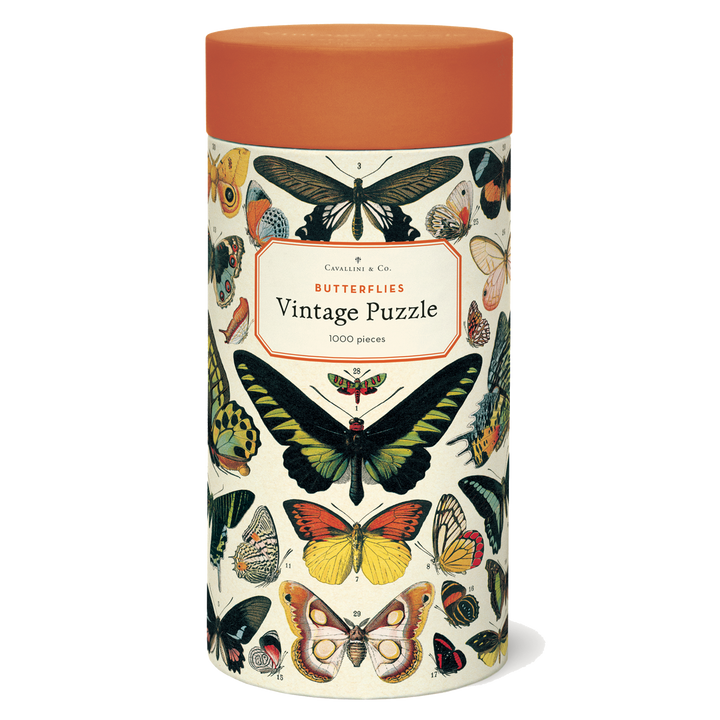 A cylindrical tube decorated with illustrations of butterflies and topped with an orange lid.