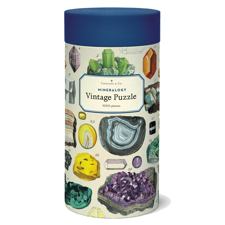 A cylindrical tube decorated with illustrations of minerals and topped with a blue lid.