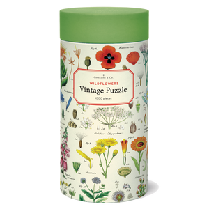 A cylindrical tube decorated with illustrations of flowers and topped with a green lid.