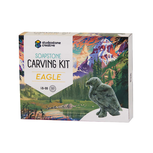 The front of a box with an illustrated BC landscape and a soapstone carving of an eagle on it.