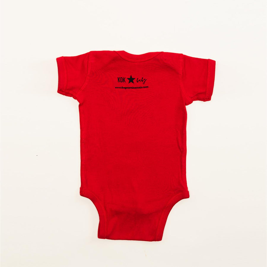 "The back of the red onesie with ""K0K baby"" printed on it."