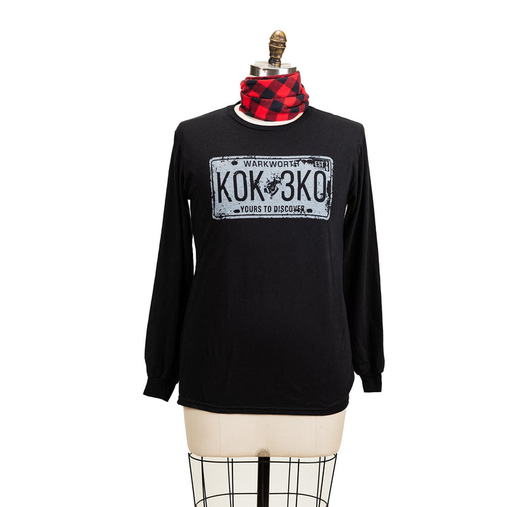 "A grey long sleeve shirt with a graphic of a white licence plate, the plate says ""Warkworth K0K 3K0 yours to discover""."