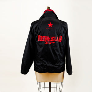 "The back of the jacket with a graphic of a star and ""Northumberland County""."