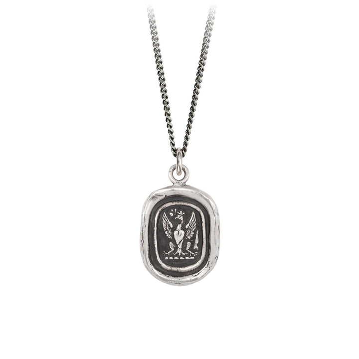 A sterling silver necklace inscribed with an eagle who's wings are spread wide.