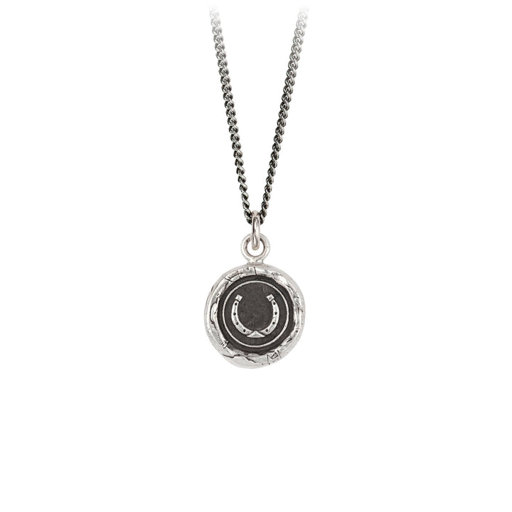 A sterling silver necklace inscribed with a horseshoe.