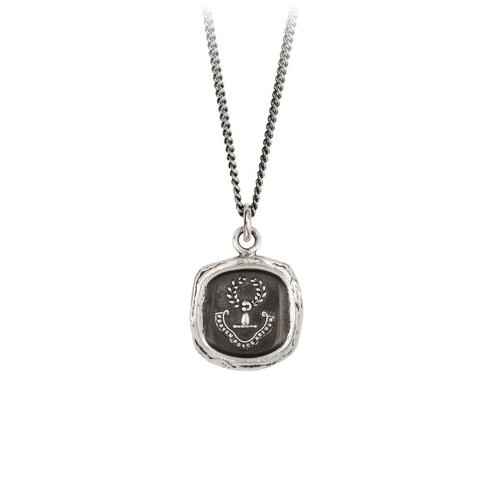 A sterling silver necklace inscribed with an arm holding a wreath and words in Latin.