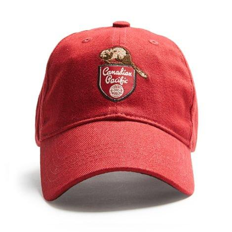 "A red ballcap with a ""Canadian Pacific Beaver"" shield patch on it."