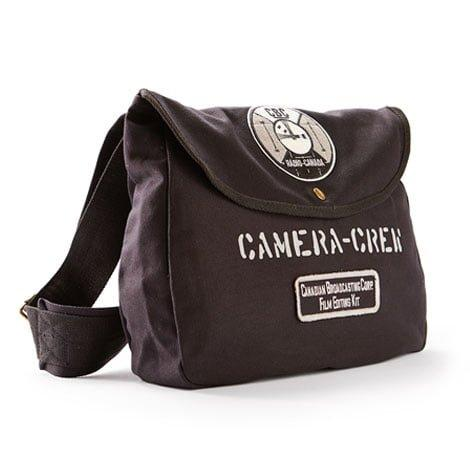 "A black shoulder bag with ""CBC Radio Canada"" and ""Canadian Broadcasting Film  Editing Kit"" patches on it."