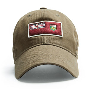 A khaki coloured ballcap with an Ontario flag patch on it.