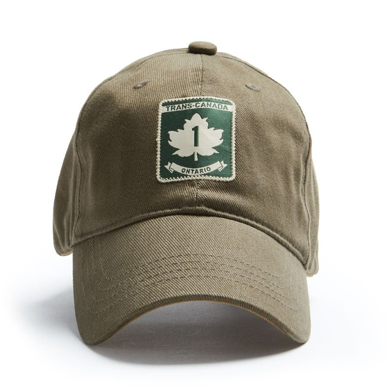 "A khaki coloured ballcap with a ""Trans-Canada Ontario"" highway patch on it."