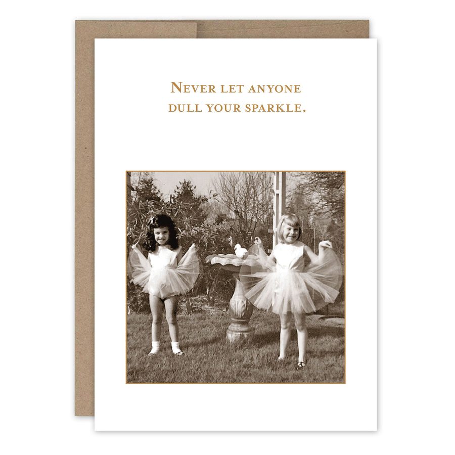 "Two little girls show off their tutu's by a small fountain, under the text ""Never let anyone dull your sparkle."""
