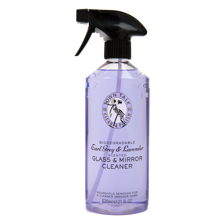"A clear spray bottle full of purple liquid with the words ""Biodegradable Earl Grey & Lavender scented glass & mirror cleaner"" on it."