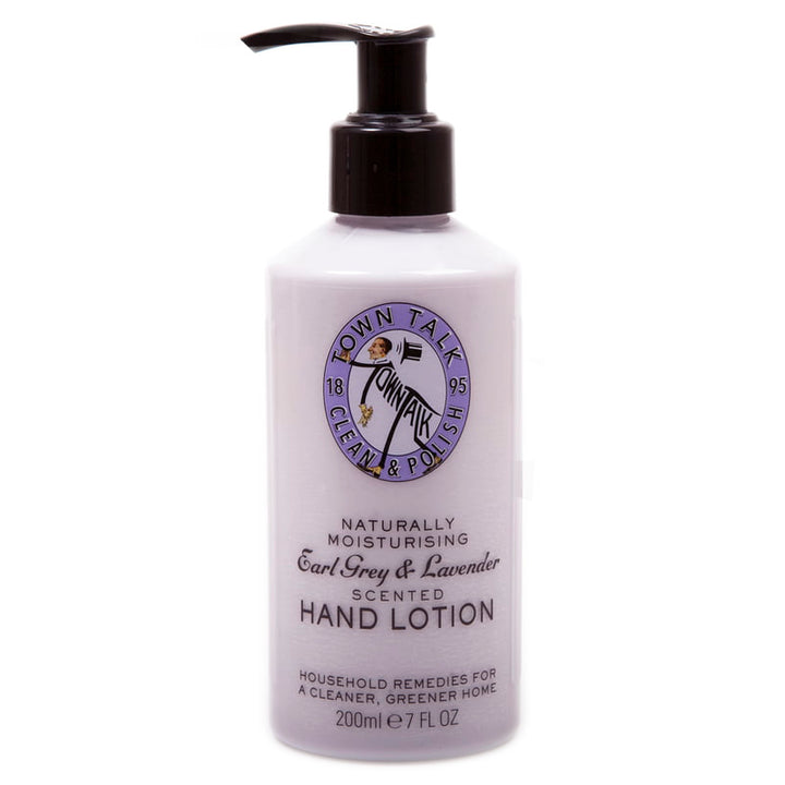 "A clear hand pump filled with soft purple cream with the words ""Naturally moisturizing Earl Grey & Lavender scented hand lotion"" on it."