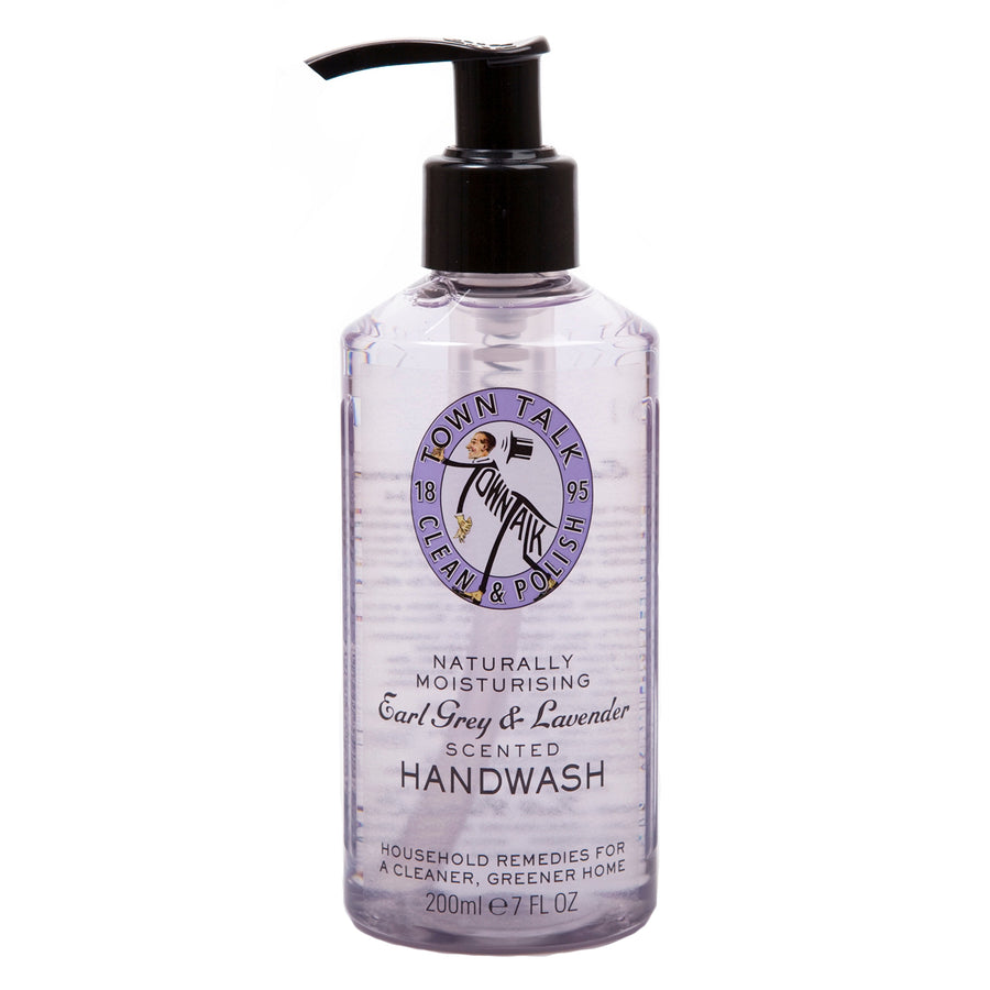 "A clear hand pump filled with light purple liquid with the words ""Naturally moisturizing Earl Grey & Lavender scented handwash"" on it."