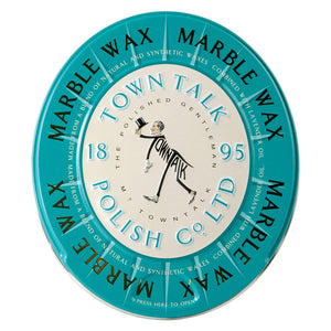 "A oval shaped teal coloured tin with a man in a tux on it. On the tin the words ""Marble wax. Made from a blend of natural and synthetic waxes combined with lavender oil."" are printed."