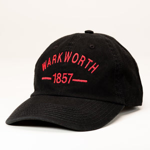"A black ballcap with ""Warkworth 1857"" stitched in red on the front."
