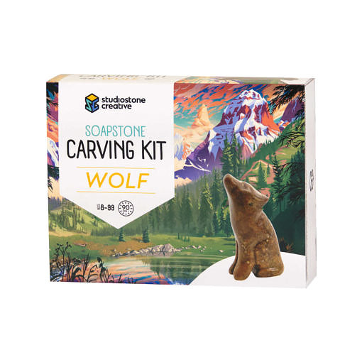 The front of a box with an illustrated BC landscape and a soapstone carving of a wolf on it.