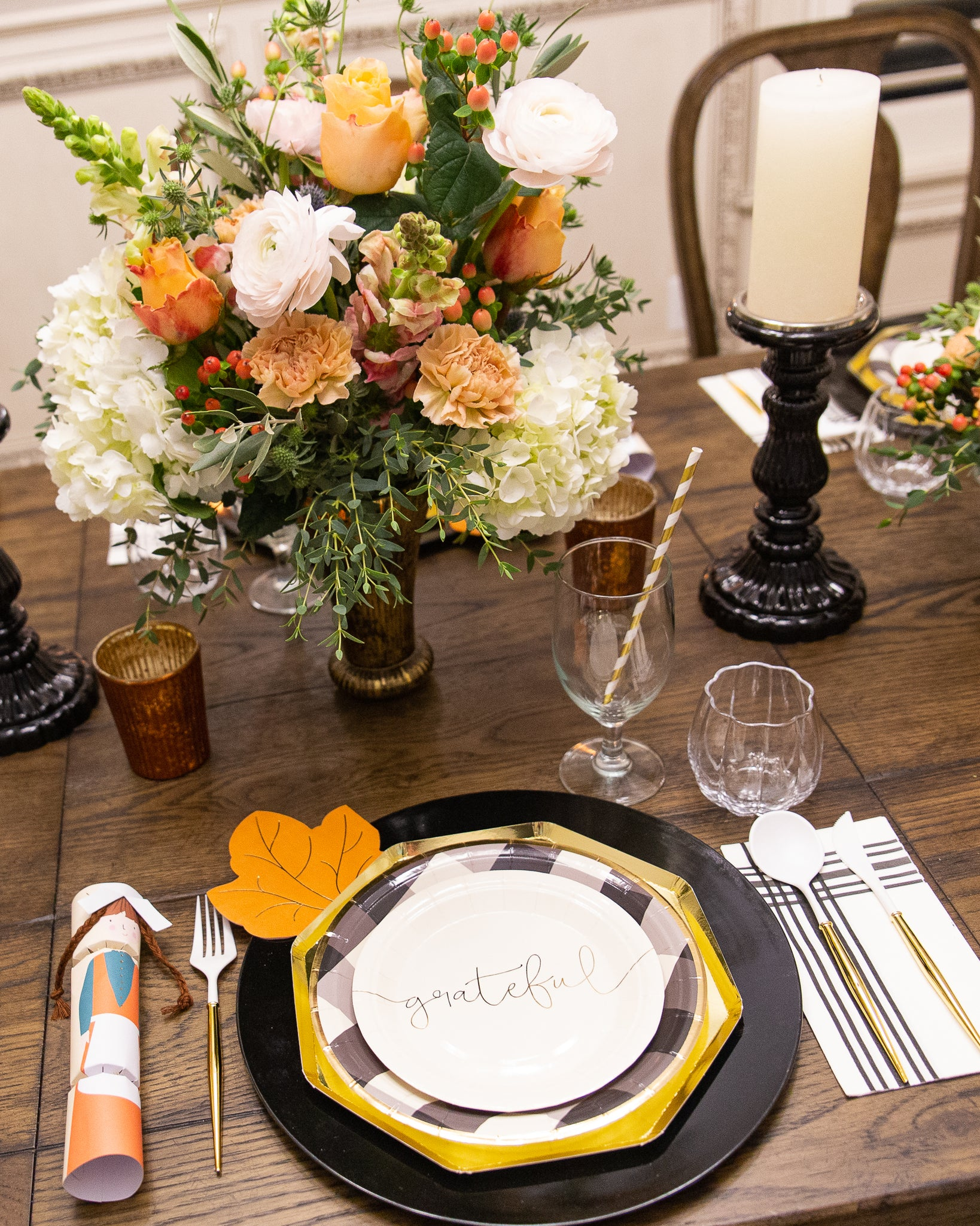 Friendsgiving table setting and flowers