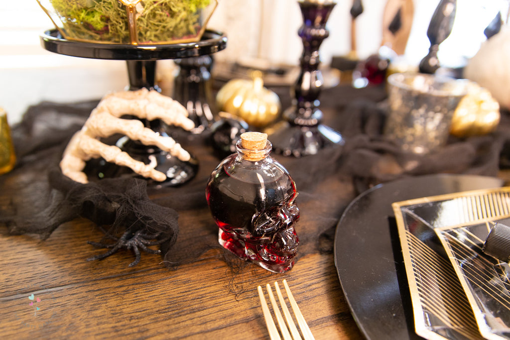 halloween table glass skull with wine