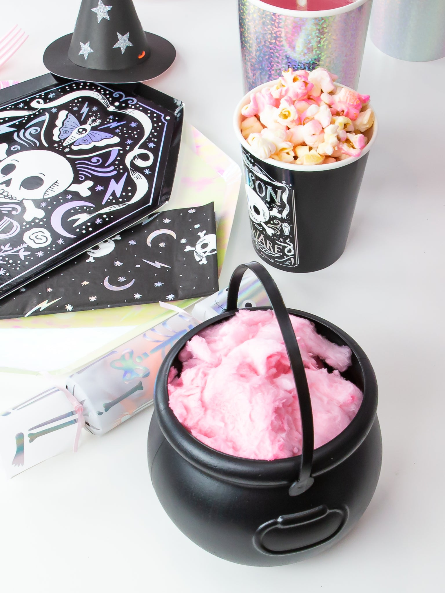 pink cotton candy in black caldron