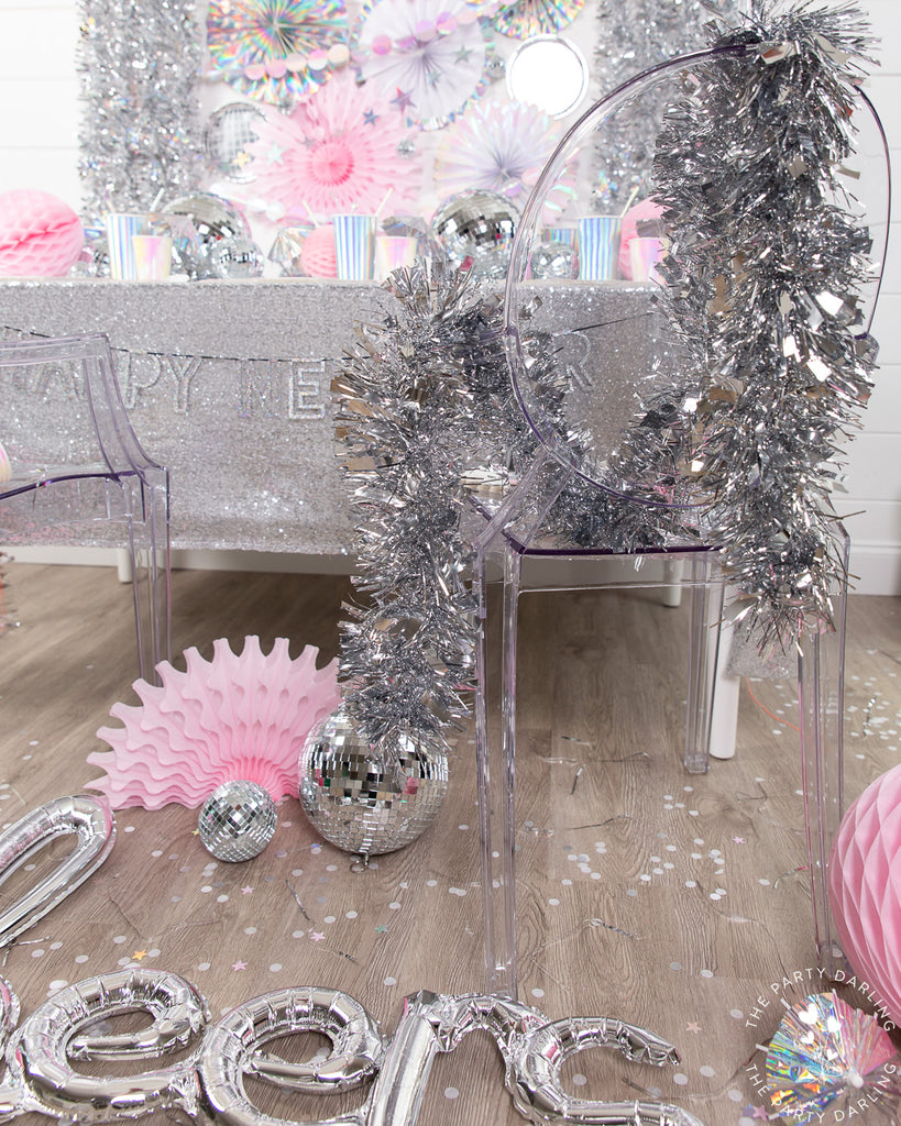 silver tinsel new year's eve decor