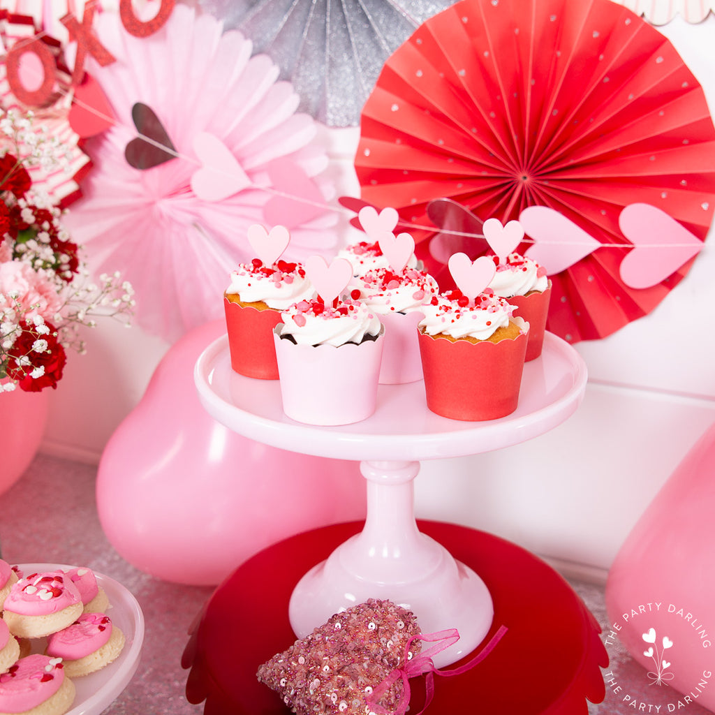 valentine cupcakes with toppers and sprinkles